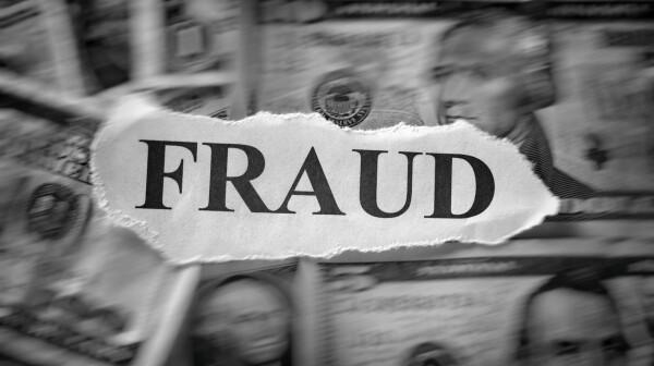 """Word """"Fraud"""" on dollar bills"""