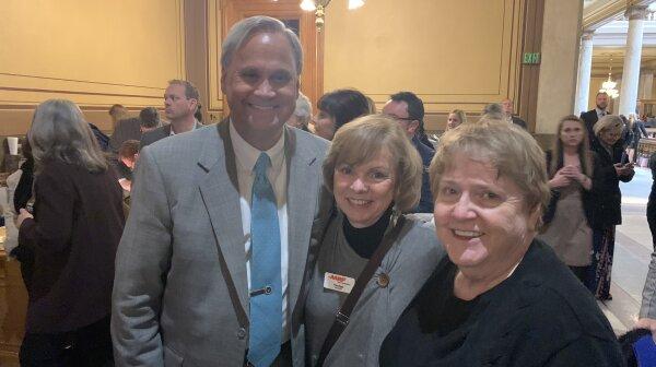 Volunteers Tish Biggs and Julie Mortier check in with Senator Jim Merritt.