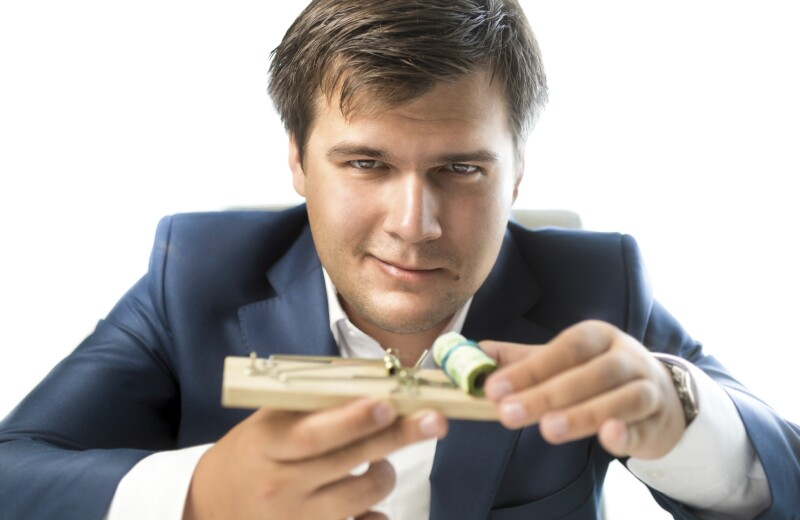 banker offering risky investment. Man holding mousetrap with mon