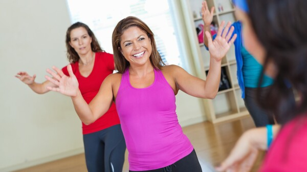 Ladies having fun while exercising during fitness class