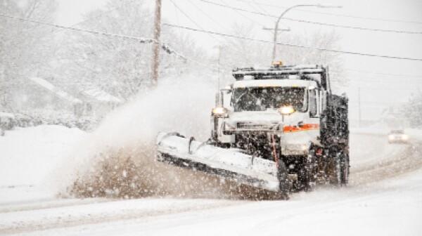 Snowplow during snowstorm_499,997
