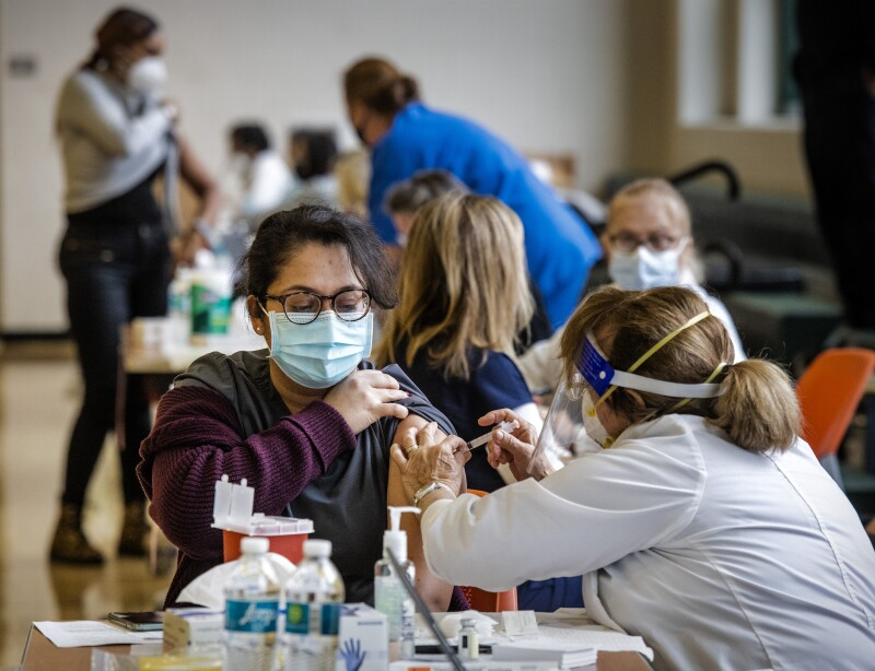 Montgomery County administers 4,000 doses of the Moderna vaccine to healthcare workers and first responders, on December 30 in Silver Spring, MD.