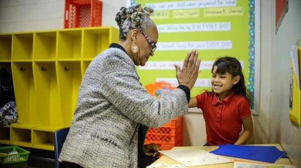 Philadelphia, Pennsylvania - October 24, 2013:Harmony, a first grader in Delilah Montemayor's class is tutored by AARP Experience Corps volunteer Margaret Plenty at Cramp Elementary School.