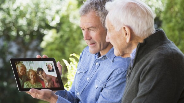 Families try to stay connected with loved ones in nursing homes