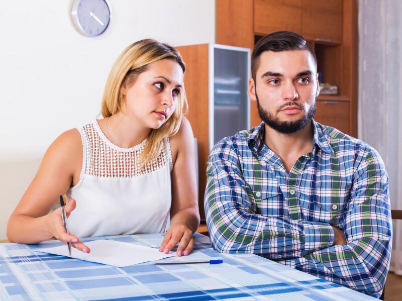 Couple discussing serious financial situation