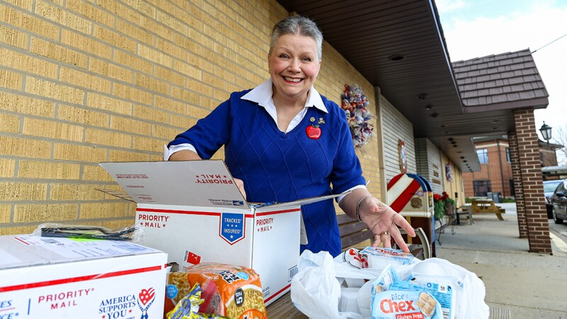 A woman packing boxes with food