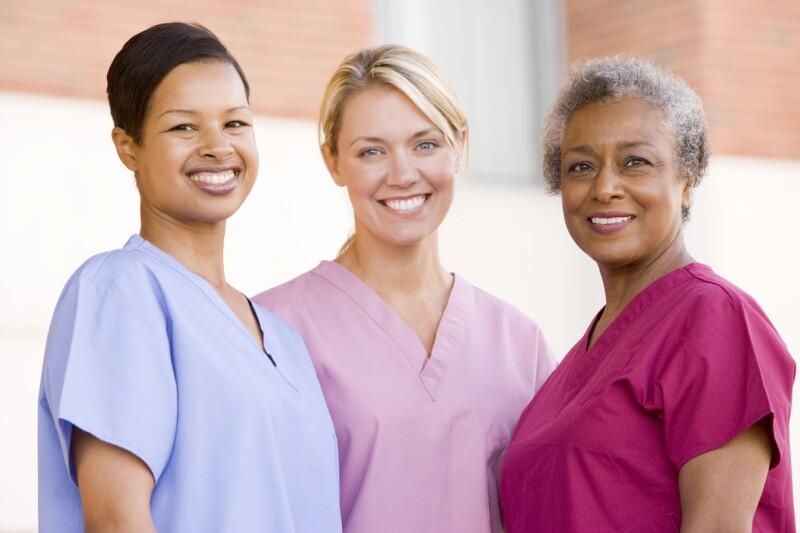 Nurses Standing Outside A Hospital