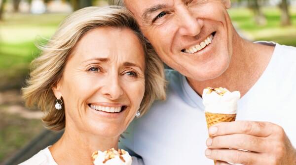 Senior Couple Holding Ice Cream Cones
