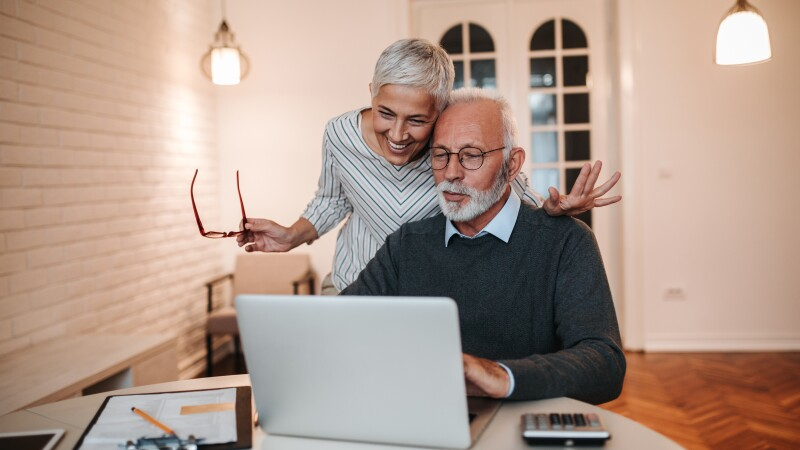 Older couple looking at a computer