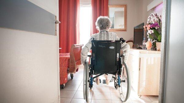 1140x655-woman-wheelchair-nursing-home-room.imgcache.rev.web.1139.655.jpg
