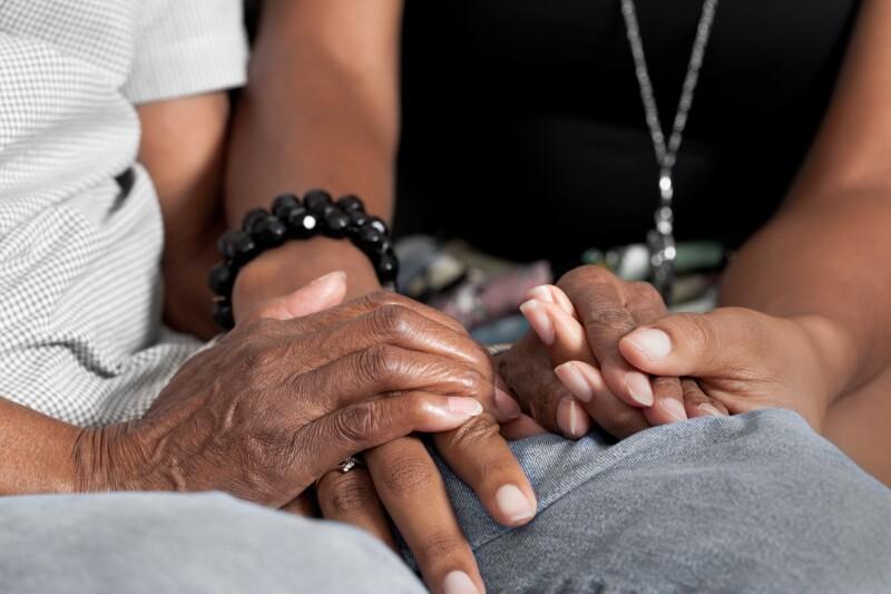 Holding seniors hands