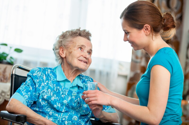 Care assistant helping an elderly patient
