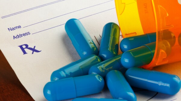 Blue Capsules on a Prescription Form