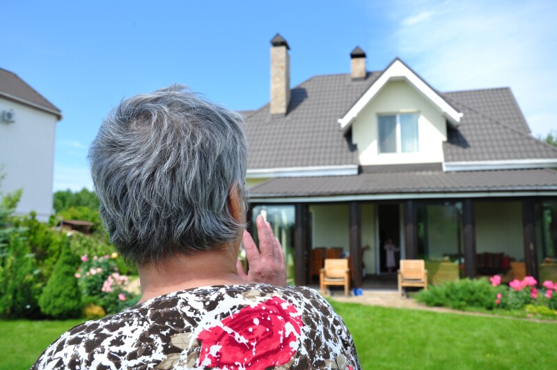 woman looking to a house