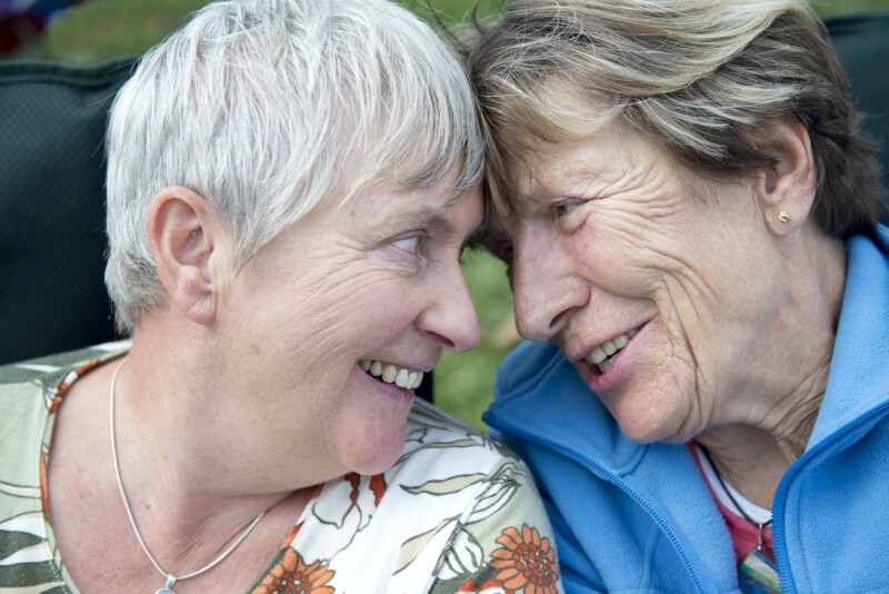 Senior Married Female Couple Laughing Together in Love