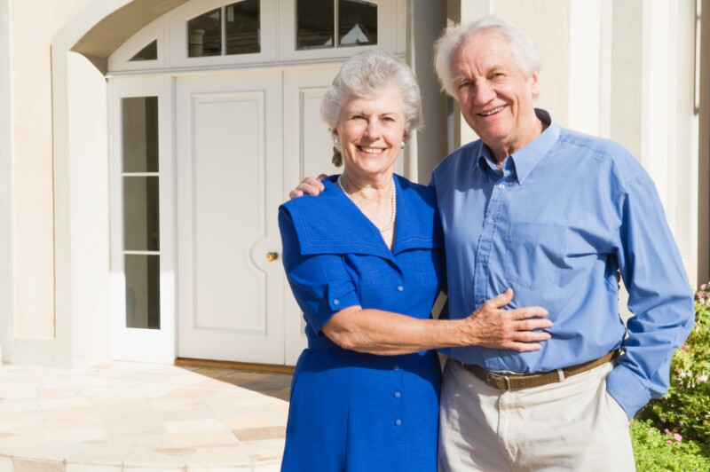 Home Fit couple in front of home iStock_000008533204Small. monkeybusinessimages