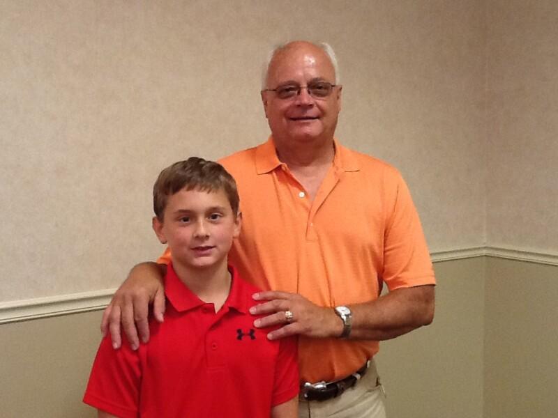 Isaac with grandpa Dennis Bartsch of Bismarck-subject of Isaac's essay