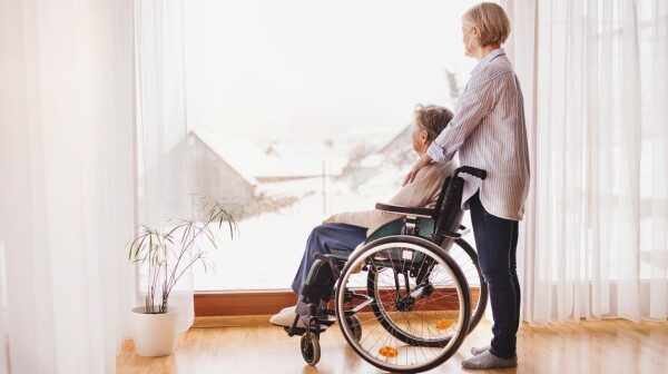Senior women with wheelchair at home.