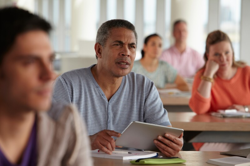 Man using digital tablet in class