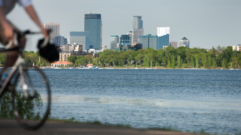 Minneapolis lifestyle scenic with biker on Lake Calhoun.