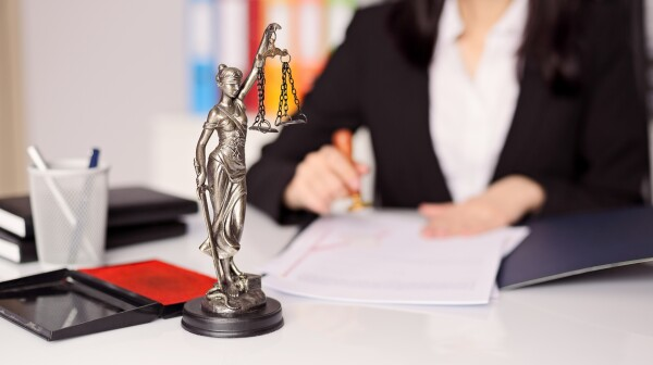 Statuette of Themis -  goddess of justice on lawyer's desk