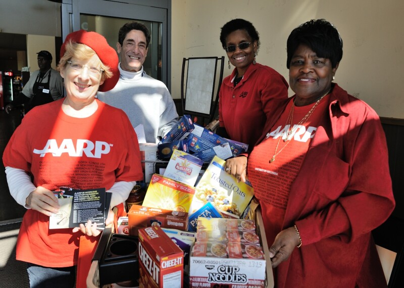 AARP DC volunteers collecting food for the needy at local grocery stores