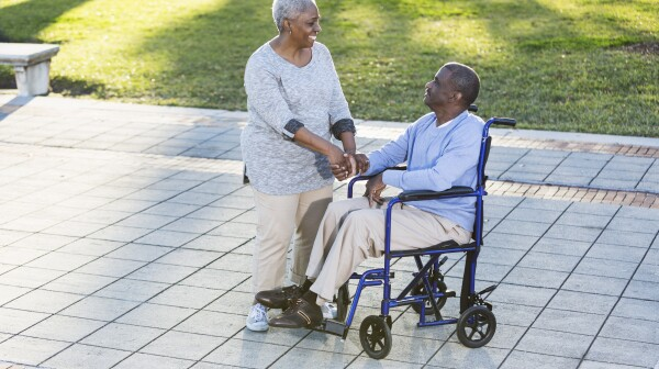 Senior African American couple, man in wheelchair