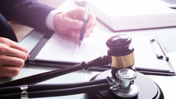 Mallet And Stethoscope Over Sound Block In Court