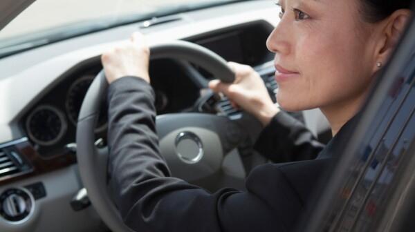 iStock_asian woman driving XiXinXing