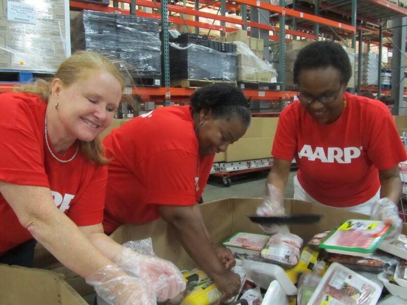 AARP volunteers food bank - showing diversity close-up