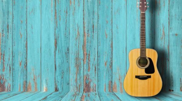 Guitar in vintage wood room.