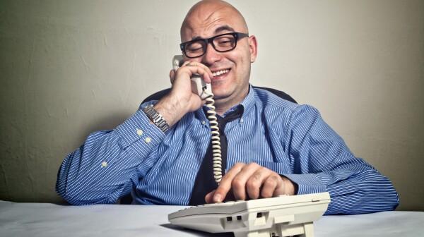 Businessman making suspicious call