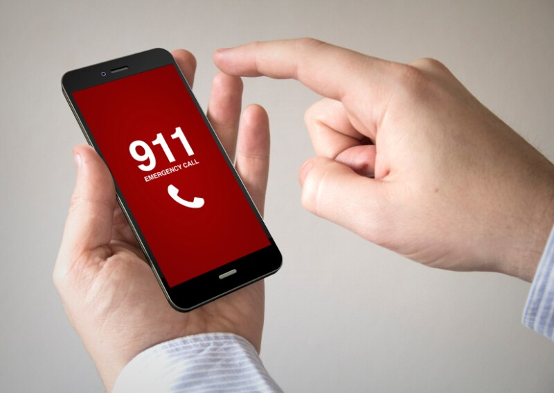 touchscreen smartphone with emergency call on the screen