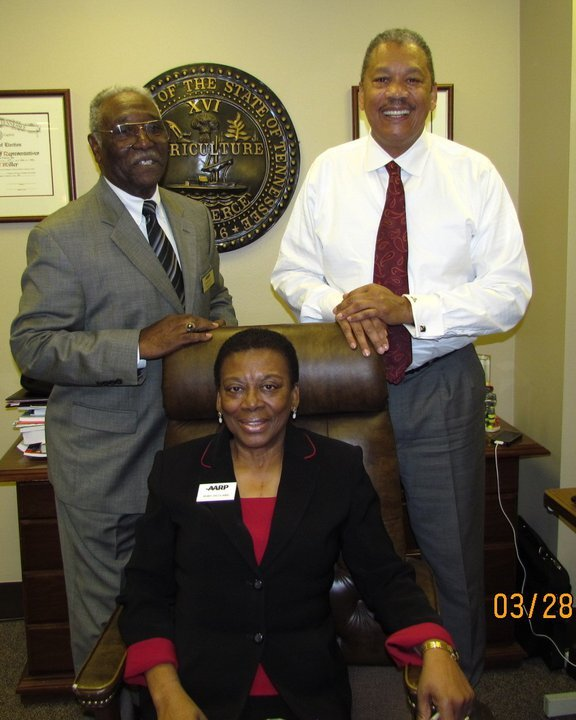 AARP volunteers often visit with their state legislators (and sometimes test their chairs!)