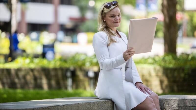 A woman sits outside