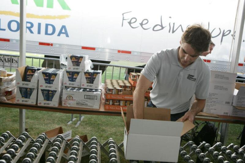 Jeff Gordon packing food box Feb 2013