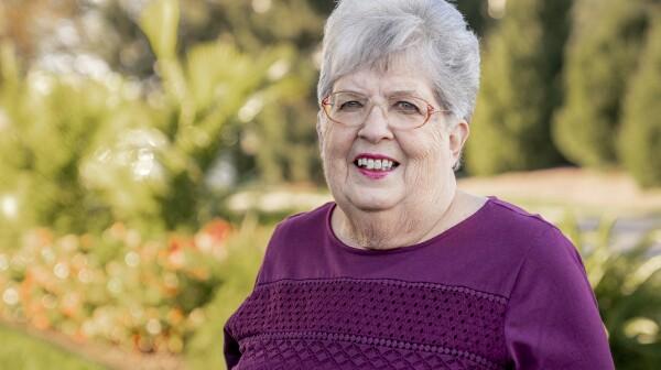 A woman smiles for a portrait photo