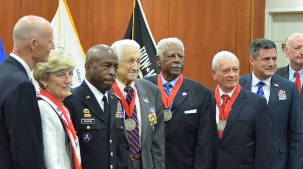 Gov. Rick Scott; Mrs. Jane Sisson Collins, widow of the late Adm. LeRoy Collins Jr.; Florida Adj. Gen. and Maj. Gen. Michael Calhoun; Lt. Gen. Snowden; Chief Master Sgt. Johnson; Col. Farmer; Col. Mike Prendergast, executive director of the Florida Department of Veterans Affairs; and Sgt. Maj. Ray Quinn, chairman of the Florida Veterans Hall of Fame Council.