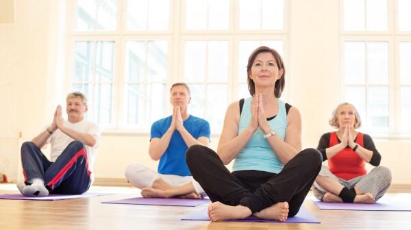 Group of senior people practising yoga