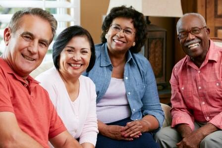 Portrait Of Senior Friends At Home Together