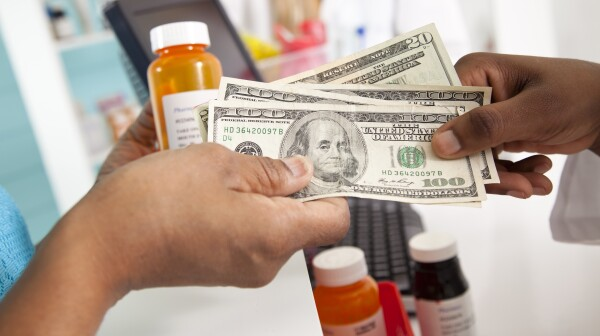 Medical: Customer pays for expensive prescriptions in pharmacy.