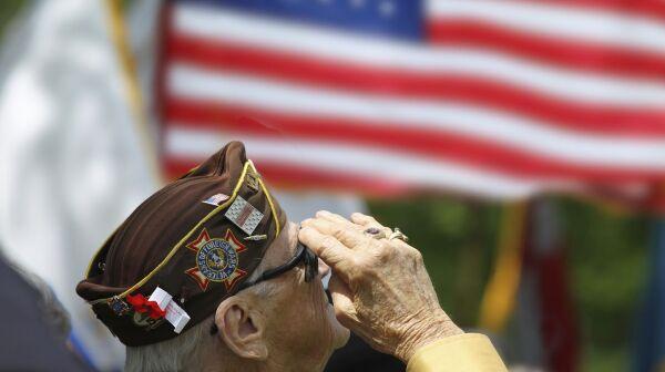 Veteran salutes flag .jpg