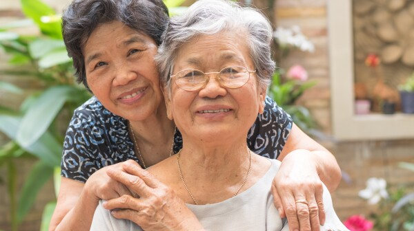 Happy senior friendship society concept. Portrait of Asian female older ageing women smiling with happiness in garden at home, nursing home, or wellbeing county