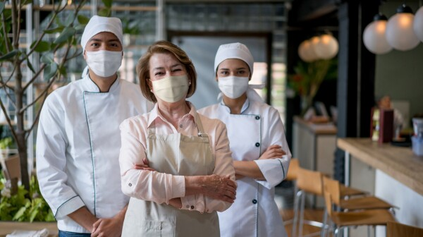 Staff working at a restaurant wearing facemasks during the pandemic