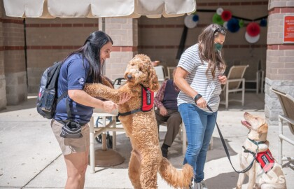 Service Dogs Bring Smiles to Residents of River Garden