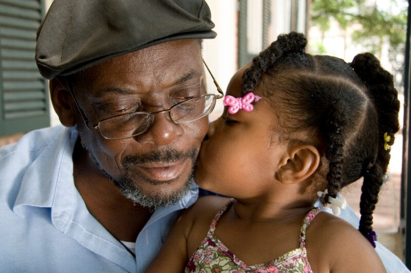 Grandfather gets kiss from granddaughter