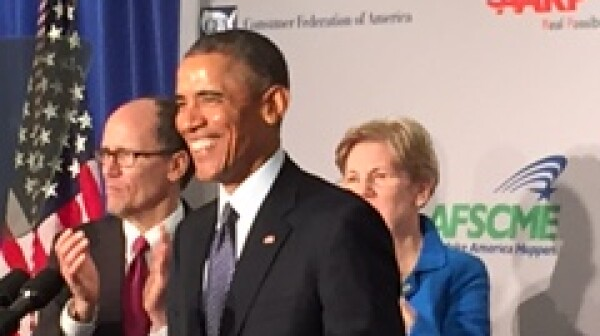 POTUS at podium -smiling