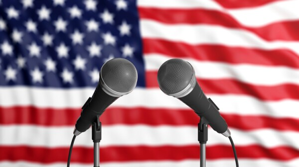 USA flag background with two microphones in front of it. Close up view. 3d illustration