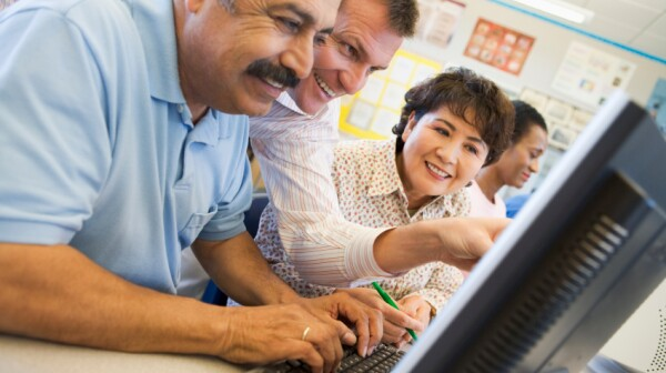 Mature students learning computer skills