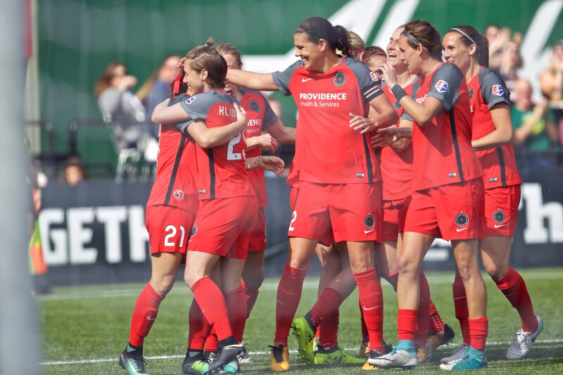 Thorns celebrate after Hayley Raso scored a goal